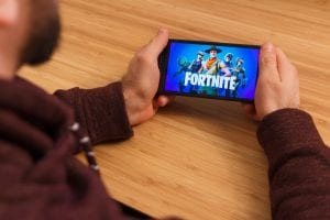 Man playing fortnite, but is it addictive