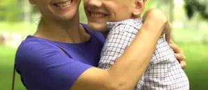 Family hugs teen in academic boarding school